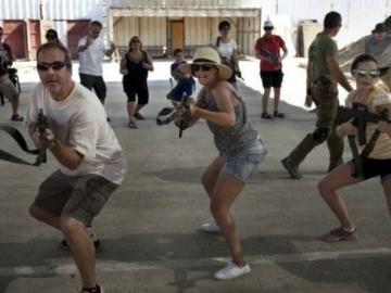 Tourists Flock to Israeli Shooting School